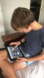 Child using Maths Invaders Online at home happily